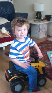 Ashley playing on his truck